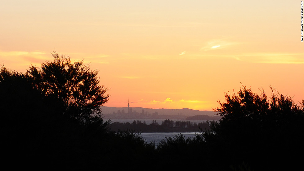 March is the perfect month to explore the New Zealand countryside. Here, Auckland is visible at sunset from Waiheke Island.