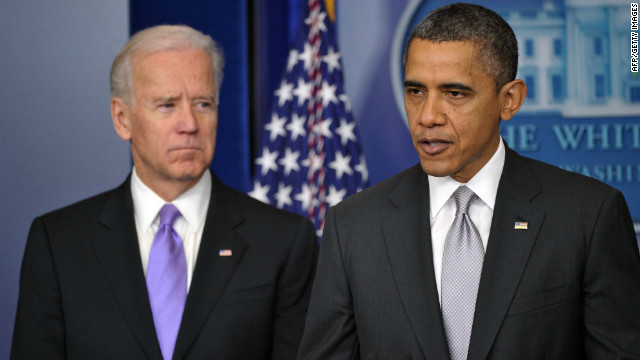 US President Barack Obama speaks as Vice President Joe Biden looks on as he delivers a statement in the Brady Briefing Room of the White House on December 19, 2012 in Washington, DC. Obama will appoint Vice President Joe Biden to lead a panel tasked with devising new policies to address gun violence after last week's school massacre in Newtown, Connecticut.