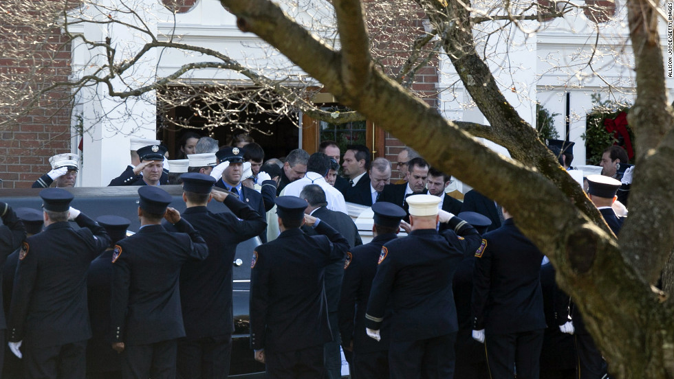 Firefighters salute as the casket of Daniel Barden, 7, a victim of the shooting at Sandy Hook Elementary School, is removed from St. Rose of Lima Church on Wednesday, December 19, 2012, in Newtown, Connecticut.