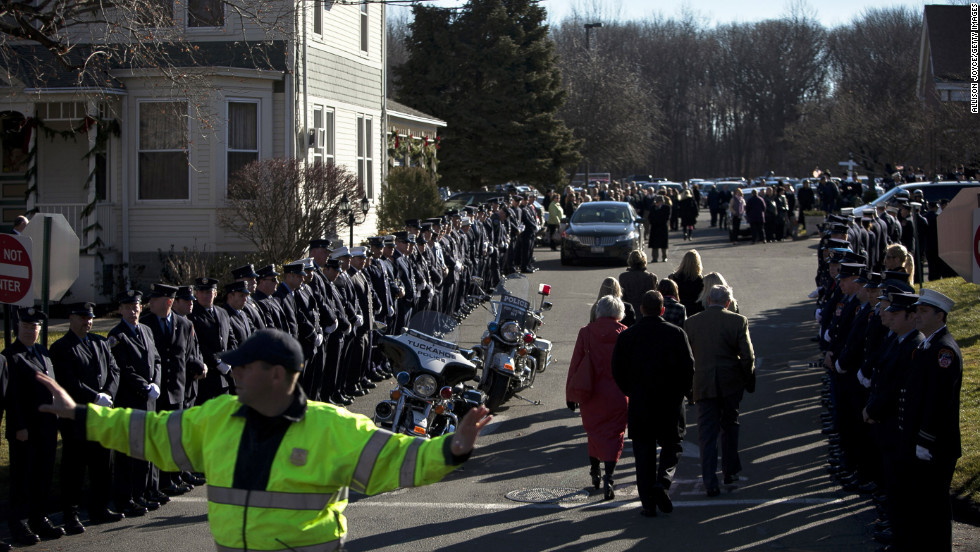 A police officer directs traffic as mourners enter the church for Charlotte Bacon's funeral on December 19.