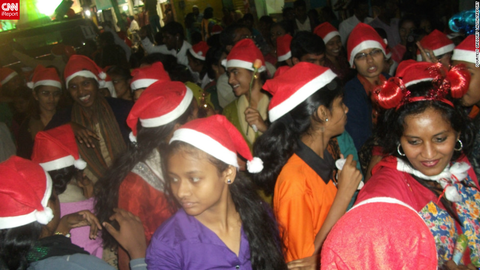 "<a href=""http://ireport.cnn.com/people/lalith1"">Gregory Lalith</a> took this image of festive revellers at the annual Christmas carnival in his hometown of Hyderabad, India.<br /><br />Trucks, cars and all manner vehicles are transformed into festively themed parade floats for the event, before setting off along the city's main thoroughfares and neighborhoods, he said."