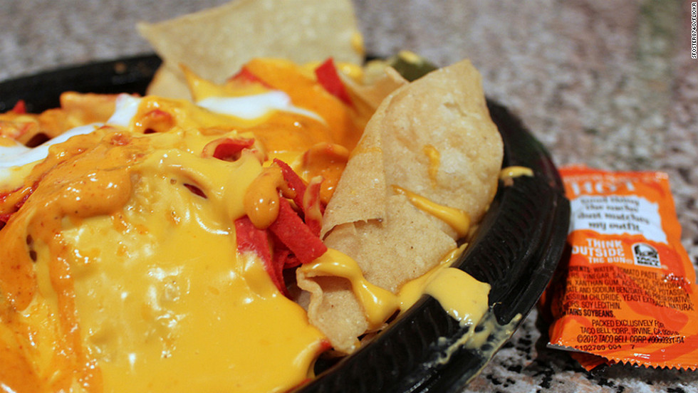 <strong>Taco Bell's Volcano Nachos:</strong> These molten cheese-laden nachos with spicy ground beef, pinto beans, and jalapeños break the nutrition bank with 970 calories and 58 grams of fat -- more calories and fat than any other single item on the menu -- plus 1,670 milligrams of sodium. <strong>Choose this instead: </strong>Nachos Supreme comes with spicy beef, beans, nacho cheese, diced tomatoes and reduced fat sour cream, but has only 430 calories, 23 grams of fat, and 690 mg of salt.
