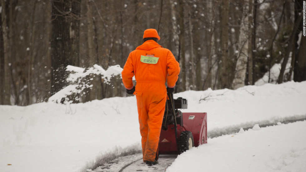 A man clears snow in Saukville, Wisconsin, on December 20.