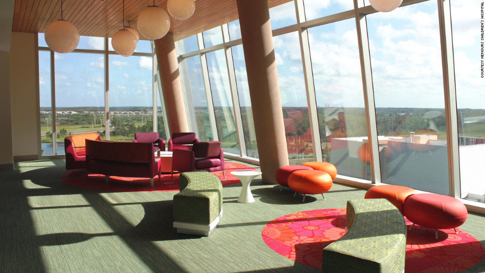 The hospital's commons area, like much of the building, has floor-to-ceiling windows to let in natural light.