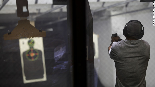 "AURORA, CO - JULY 22: A member of Firing-Line prepares fires his weapon at the gun range July 22, 2012 in Aurora, Colorado. Firing-Line is located not far from where suspect gunman James Eagan Holmes, 24, is accused of killing 12 people at a screening of the new ""Batman"" film last Friday. (Photo by Joshua Lott/Getty Images)"