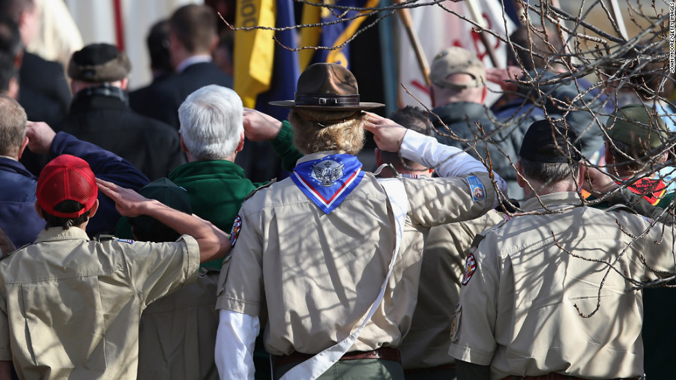 Boy scouts salute as a funeral procession for Benjamin Wheeler enters the Trinity Episcopal Church on December 20, in Newtown, Connecticut.