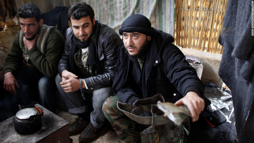 Free Syrian Army members display shrapnel from what they say are the remains of a rocket fired from the Syrian army in northern Aleppo on Thursday, December 20.