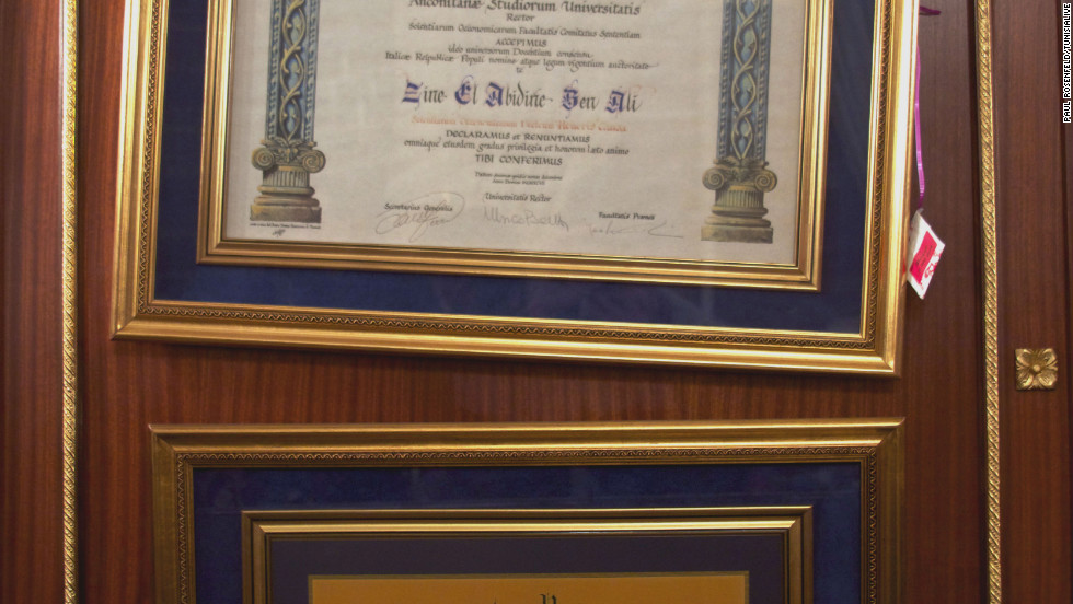 "Two framed degree certificates hang in Ben Ali's personal study -- the top one is a 1997 award from the University of Ancona, Italy, and underneath a doctorate in political science awarded by Kensington University in 1999. The U.S. institution was shut down by the state of California for granting diplomas by mail and having ""little or no rigor or credible academic standards."""