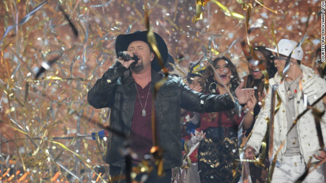 """X Factor"" season two winner Tate Stevens performs during show's finale."