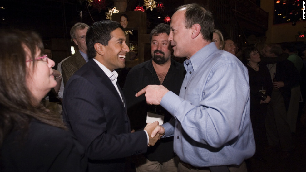 Walton, right, and Dr. Sanjay Gupta, CNN's chief medical correspondent, at the network's 25th anniversary celebration.