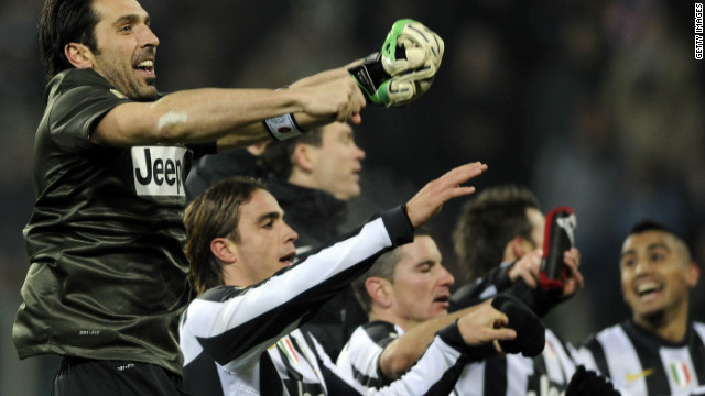Juventus players including goalkeeper Gianluigi Buffon celebrate their last-gasp win over Cagliari.