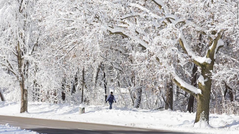 A pedestrian walks across the campus the University of Wisconsin-Madison a day after a record snow fall on Friday.