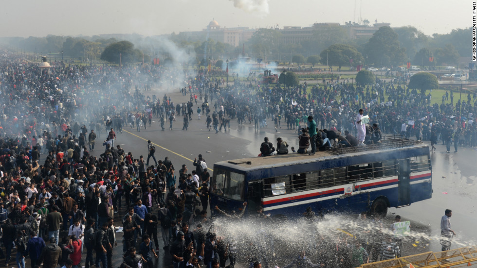 Police spray water and fire tear gas towards demonstrators on December 22.