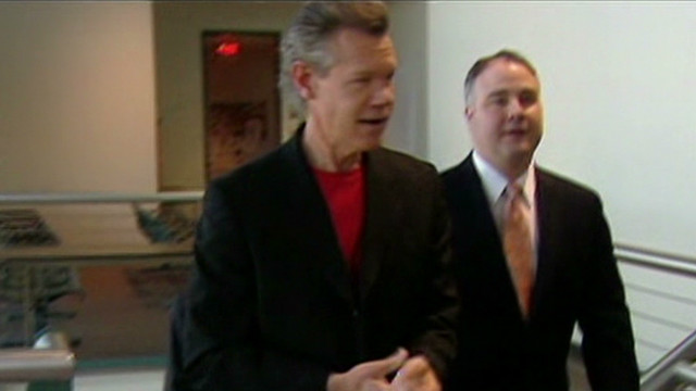 Singer Randy Travis pleads not guilty
