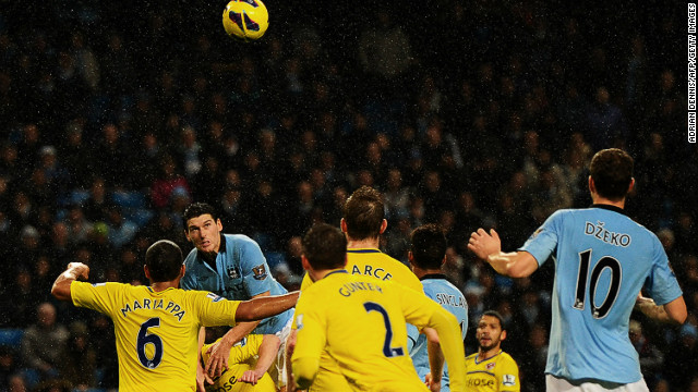 Gareth Barry scores the winner against Reading at a rainy Etihad Stadium to close gap on Manchester United to three points.