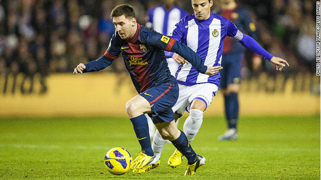 Lionel Messi ends the year on the front foot, scoring his 91st goal of 2012 in Barcelona's 3-1 win at Real Valladolid.
