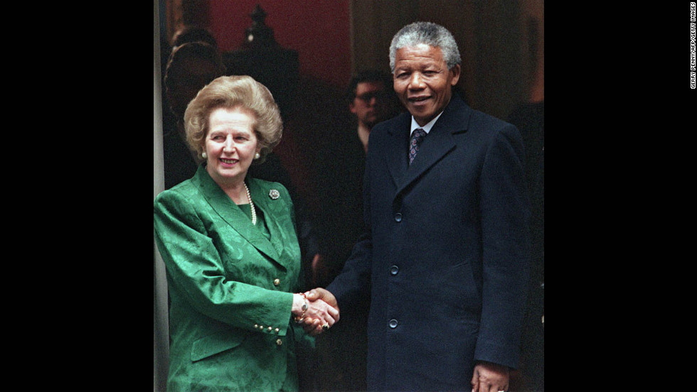 Thatcher greets Nelson Mandela on the steps of 10 Downing Street in July 1990. The anti-apartheid activist and future South African president had been freed that year after more than 25 years as political prisoner.