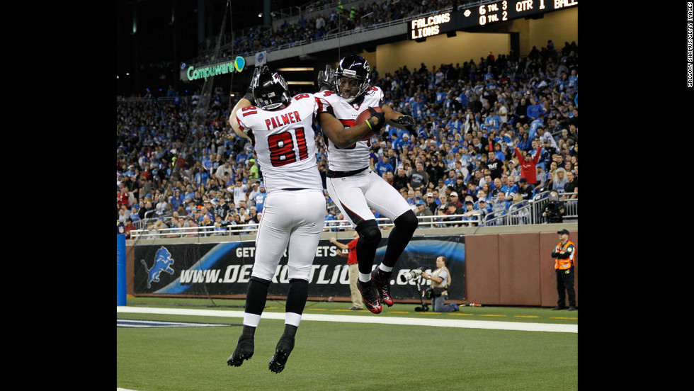 Roddy White of the Atlanta Falcons celebrates a first-quarter touchdown with Michael Palmer on Saturday.