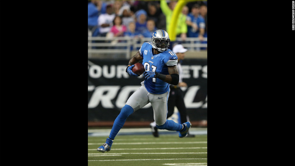 Calvin Johnson of the Detroit Lions carries the ball on Saturday.