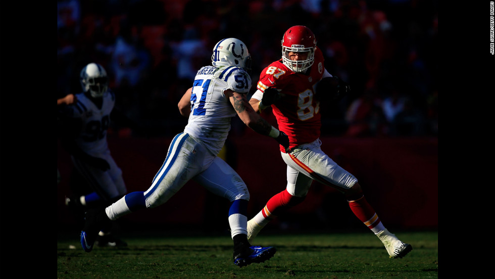 Tight end Steve Maneri of the Chiefs carries the ball as inside linebacker Pat Angerer of the Colts defends on Sunday.
