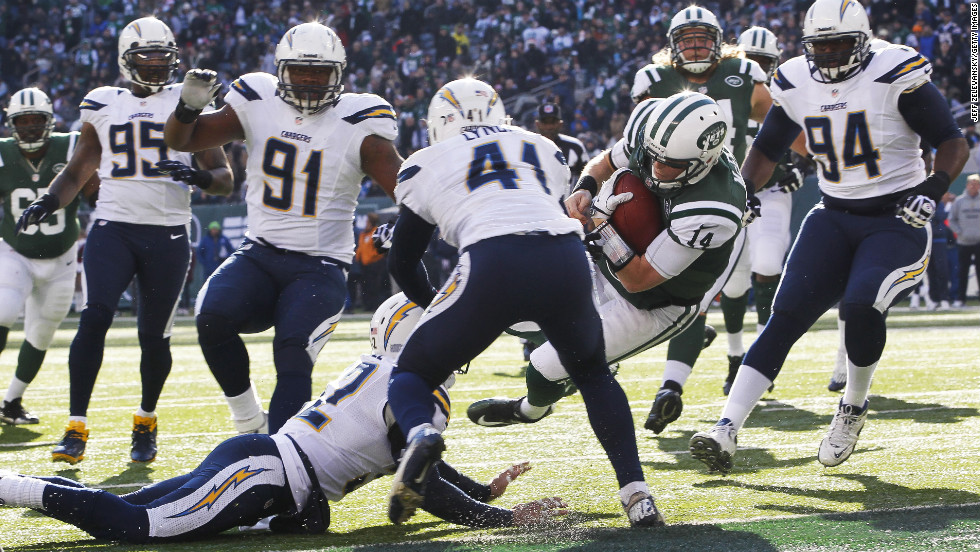 Greg McElroy of the Jets scrambles for a first down against the Chargers on Sunday.