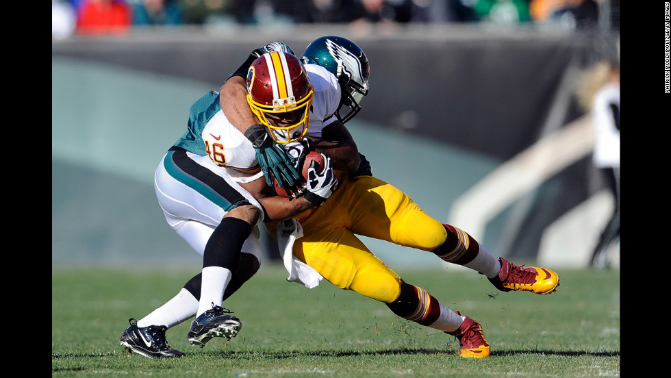 Alfred Morris of the Redskins is tackled by Mychal Kendricks of the Eagles on Sunday.