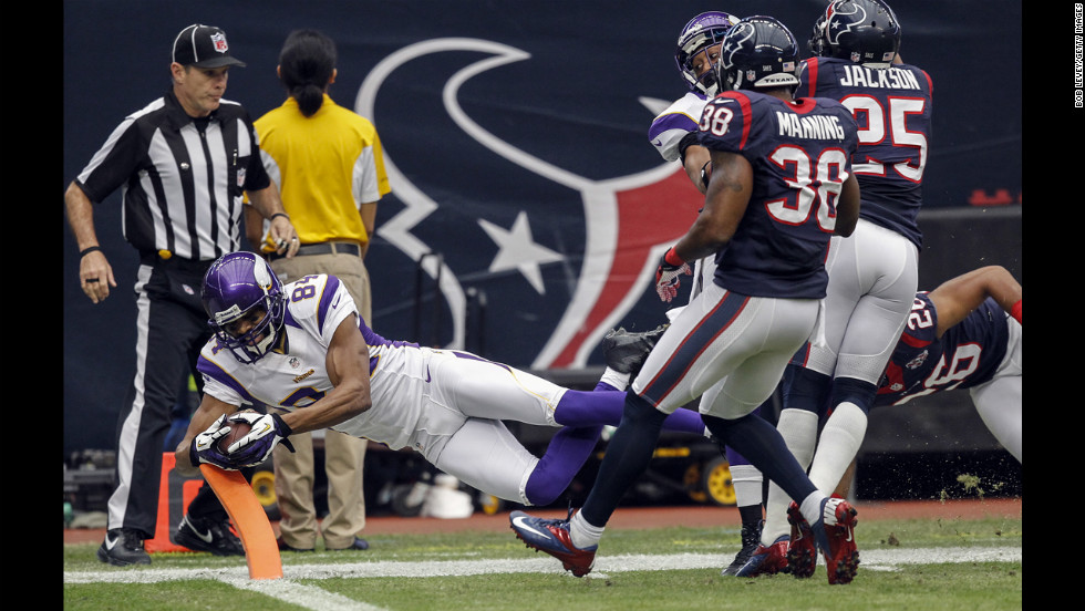 Michael Jenkins of the Vikings dives for the goal line but was ruled out of bounds as Danieal Manning and Kareem Jackson of the Texans defend on Sunday.