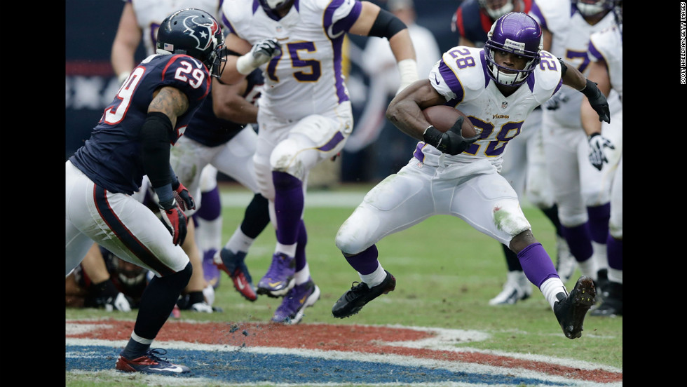 Adrian Peterson of the Vikings runs upfield against the Texans on Sunday.