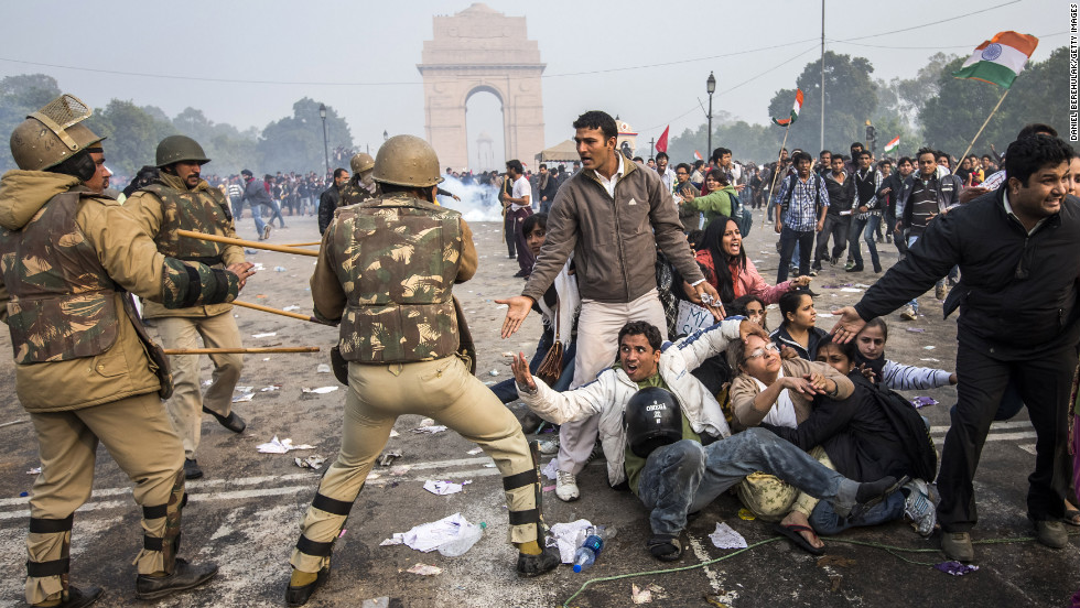 Police attempt to disperse protesters on December 23. For a second day, demonstrators were blasted with water cannons in the Indian capital. While some dispersed, others huddled tightly in a circle to brave high-pressure streams in the cold weather.