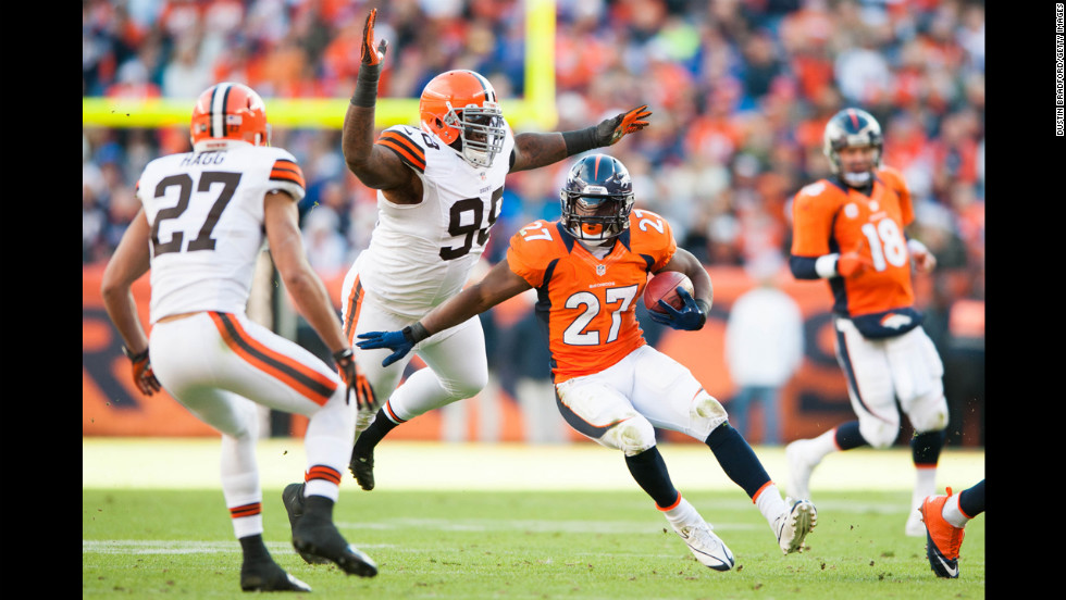 Running back Knowshon Moreno of the Denver Broncos rushes as defensive end Juqua Parker of the Cleveland Browns attempts to tackle on Sunday.