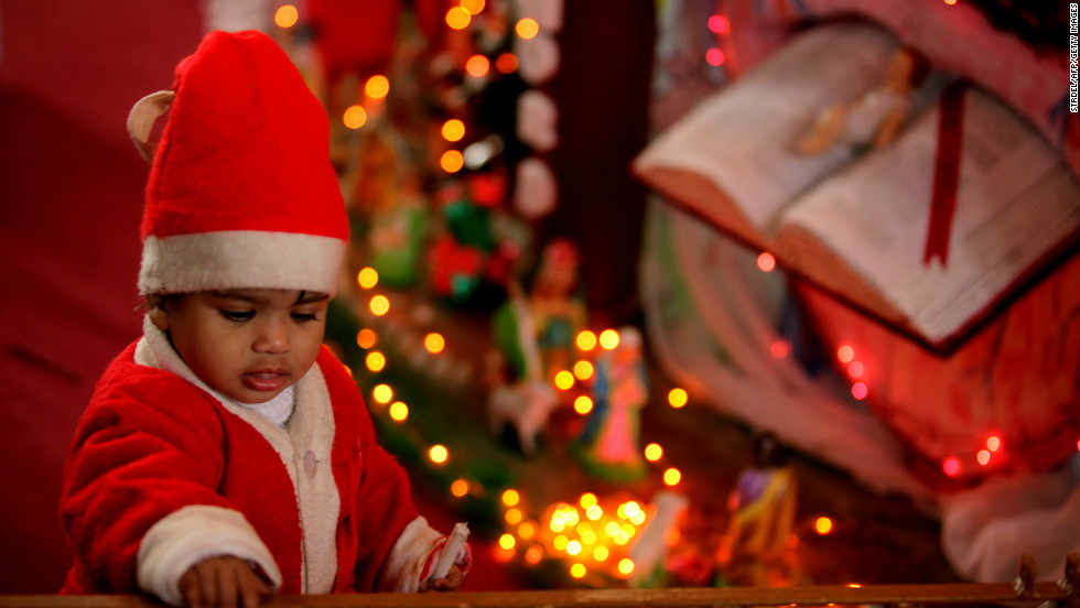A child dressed as Santa Claus plays at a church during Christmas celebrations in Jammu, India, on Tuesday.