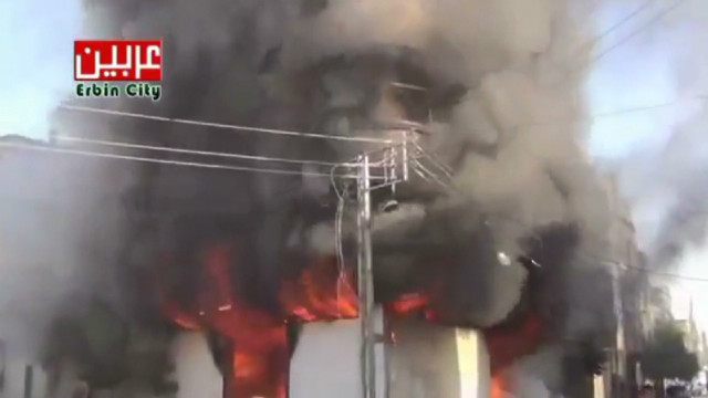 Activists: Building burns amid air raids