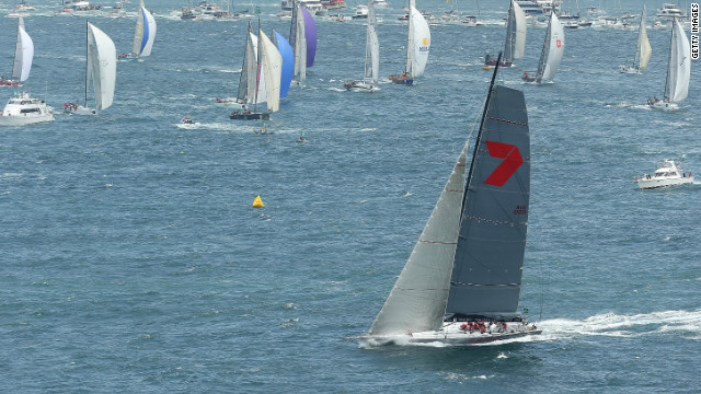 Wild Oats XI leads the fleet out of Sydney harbor on Boxing Day in the Rolex Sydney-Hobart yacht race.