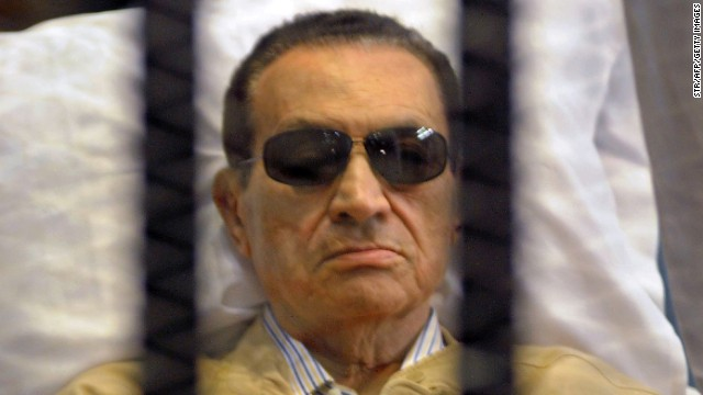 Ousted Egyptian president Hosni Mubarak siting inside a cage in a courtroom during his verdict hearing in Cairo on June 2.