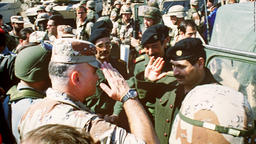 Schwarzkopf salutes Iraqi Lt. Gen. Sultan Hashim Ahmad at the end of their talks to set cease-fire terms in the Gulf War on March 3, 1991, at a captured Iraqi air base.