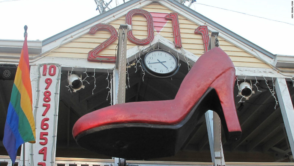 Marion as Sushi gets inside an 8-foot-long red shoe, made out of fiberglass and stainless steel. The shoe is lowered over the last hour of the old year to ring in the new one.