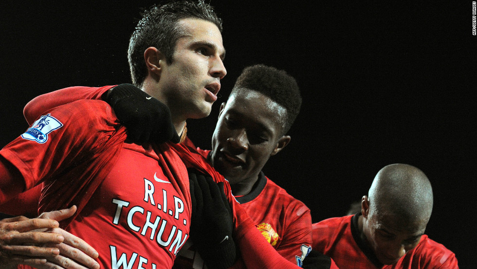 Substitute Robin van Persie (L) celebrates after sealing Manchester United's 2-0 win over with West Brom, scoring his 14th league goal this season.
