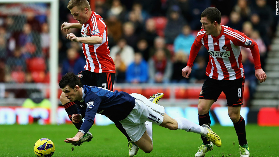 Tottenham went third with a 2-1 win at Sunderland but the victory was marred by Gareth Bale's third booking this season for alleged diving -- the Wales winger will now be suspended for the next match against Reading.