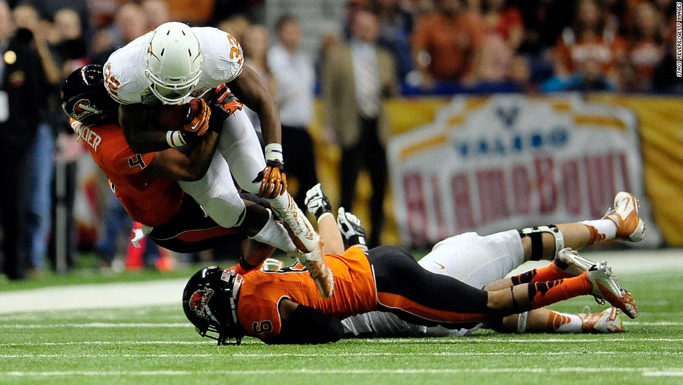 Johnathan Gray of the University of Texas Longhorns is brought down by D.J. Alexander of the Oregon State Beavers during the Valero Alamo Bowl at the Alamodome on Saturday, December 29, in San Antonio.