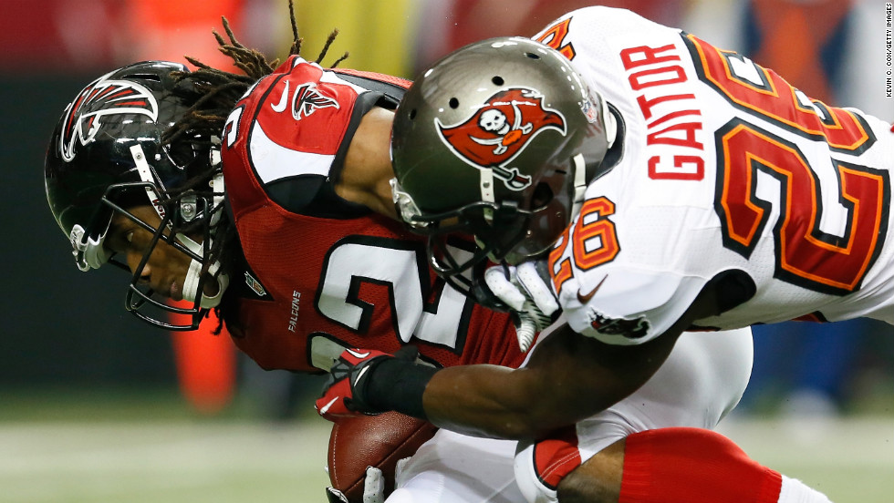 Anthony Gaitor of the Tampa Bay Buccaneers tackles Jacquizz Rodgers of the Atlanta Falcons at the Georgia Dome in Atlanta on Sunday.