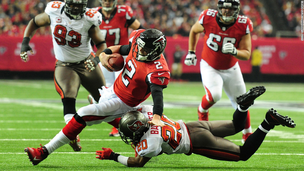 Matt Ryan of the Atlanta Falcons is tackled by Ronde Barber of the Tampa Bay Buccaneers on Sunday.