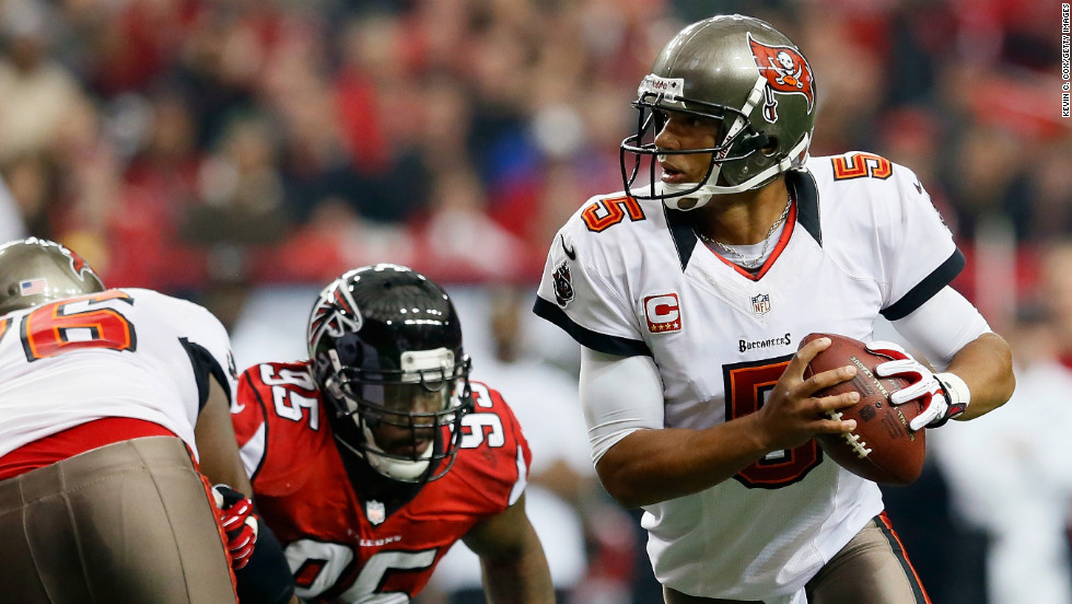 Josh Freeman of the Tampa Bay Buccaneers rolls out of the pocket against the Atlanta Falcons on Sunday.