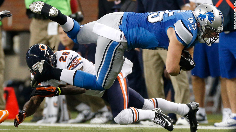 Shaun Chapas of the Detroit Lions is tackled by Tim Jennings of the Chicago Bears on Sunday.