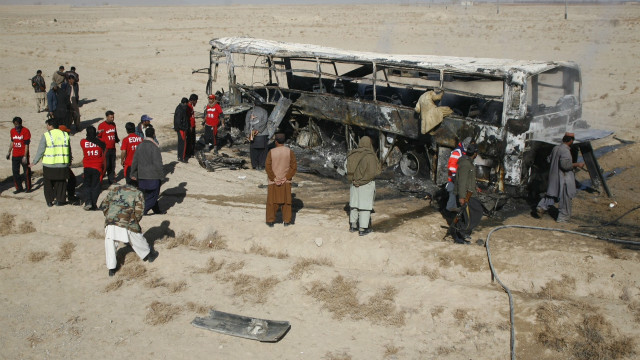 The burned out remains of the piligrim's bus that was attacked in the Balochistan province of Pakistan.