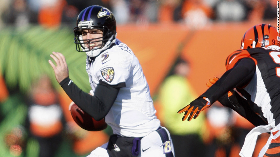 Joe Flacco of the Baltimore Ravens scrambles out of the pocket on Sunday.