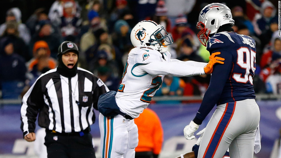 Reggie Bush of the Miami Dolphins shoves Chandler Jones of the New England Patriots following a play on Sunday.