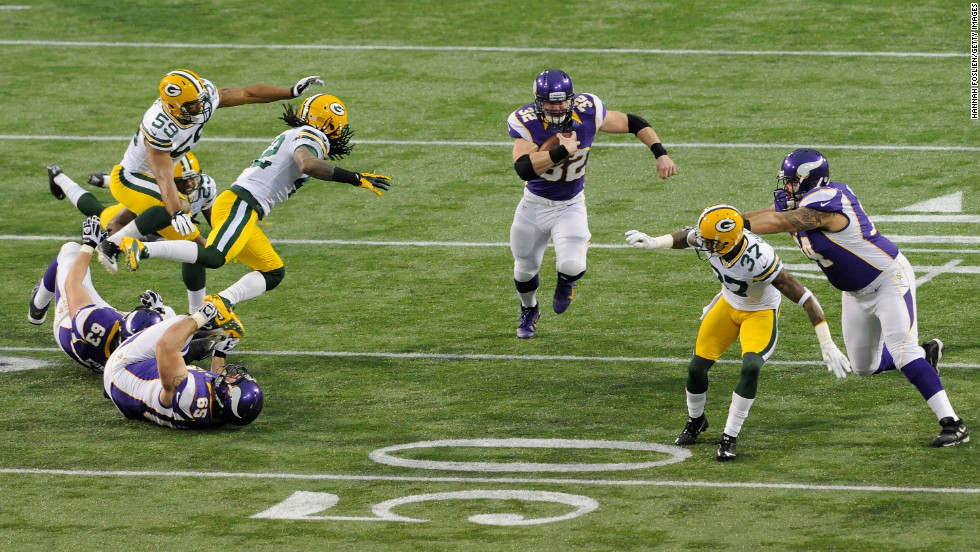 Toby Gerhart of the Minnesota Vikings carries the ball against the Green Bay Packers on Sunday at Mall of America Field at the Hubert H. Humphrey Metrodome in Minneapolis.