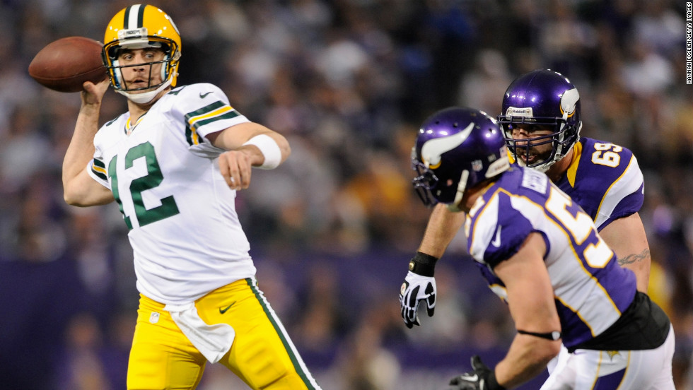 Aaron Rodgers of the Green Bay Packers looks to pass the ball under pressure from Jared Allen and Chad Greenway of the Minnesota Vikings on Sunday.