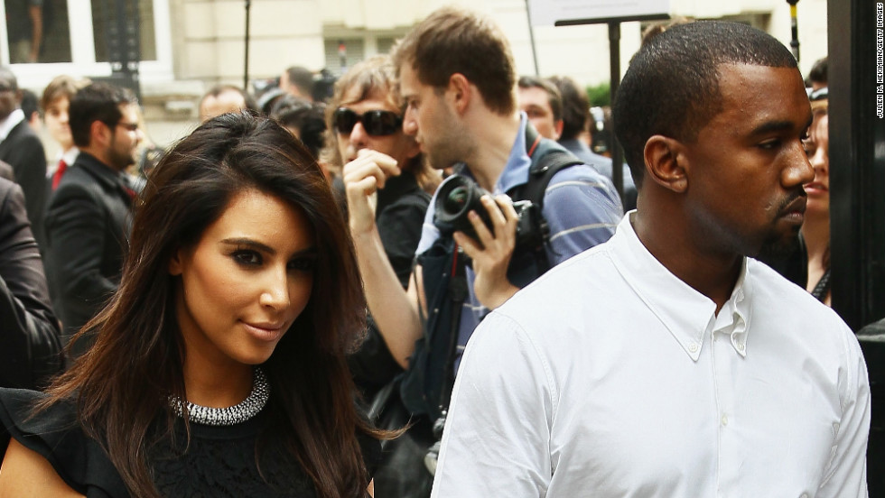 In July 2012, Kim and Kanye kept one another close as they exited the Valentino Haute-Couture Show during Paris Fashion Week.