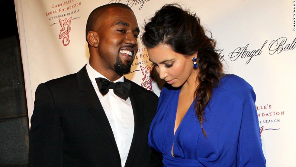 We'd love to know what Kanye was whispering in Kim's ear as they clung to one another at the Angel Ball 2012 in New York City on October 22.